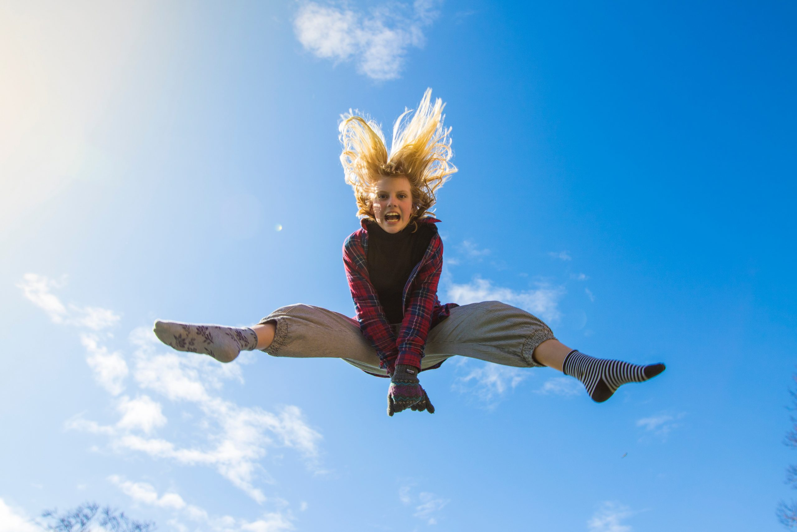 Girl jumping to show energy; supporting energy levels naturally.