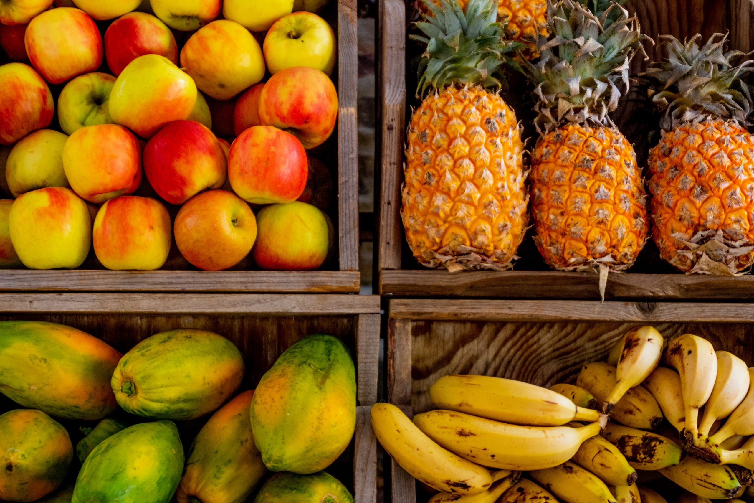 Fruits in crates; supporting immune system health naturally.