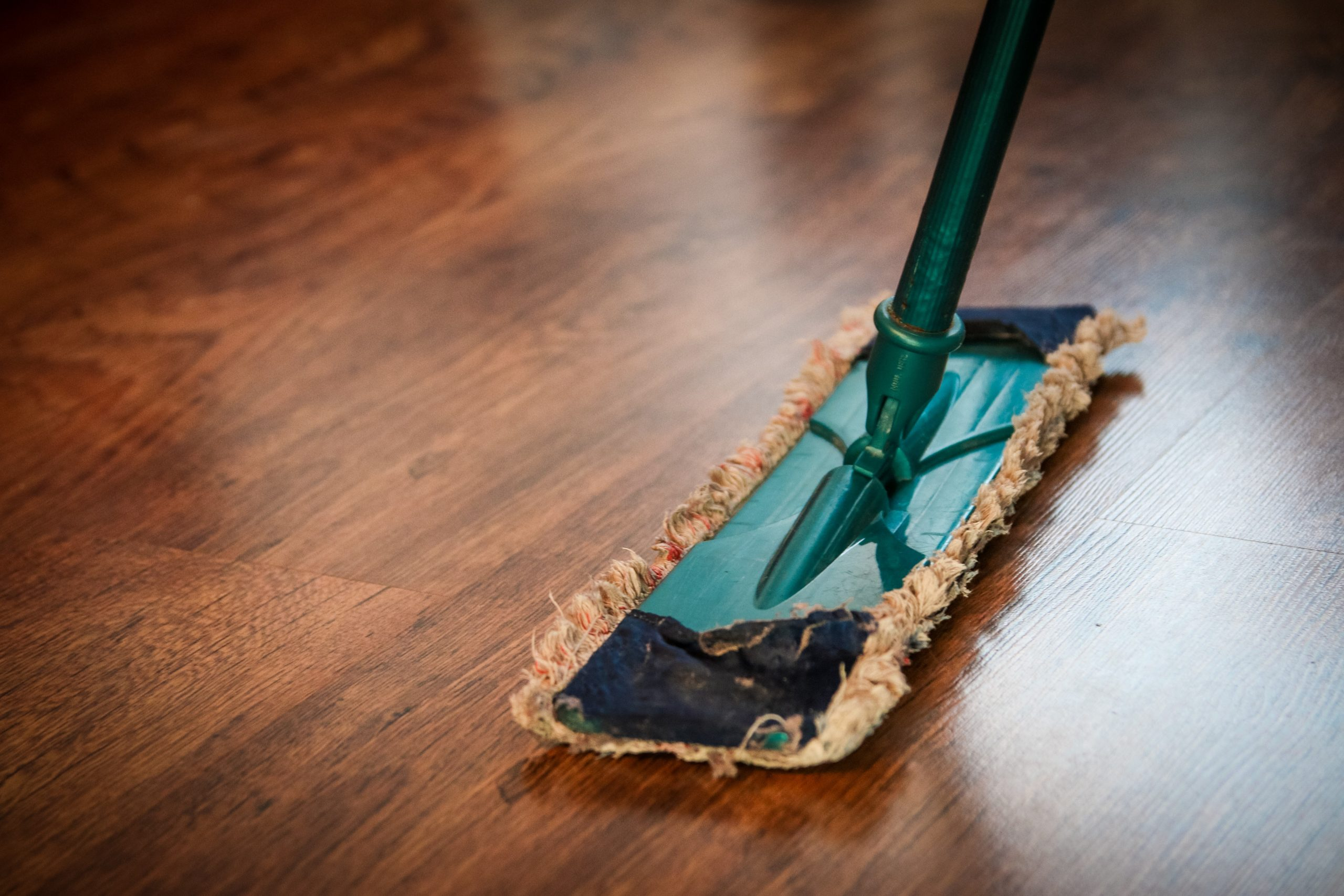 Mop on wood floor; cleaning your house naturally.