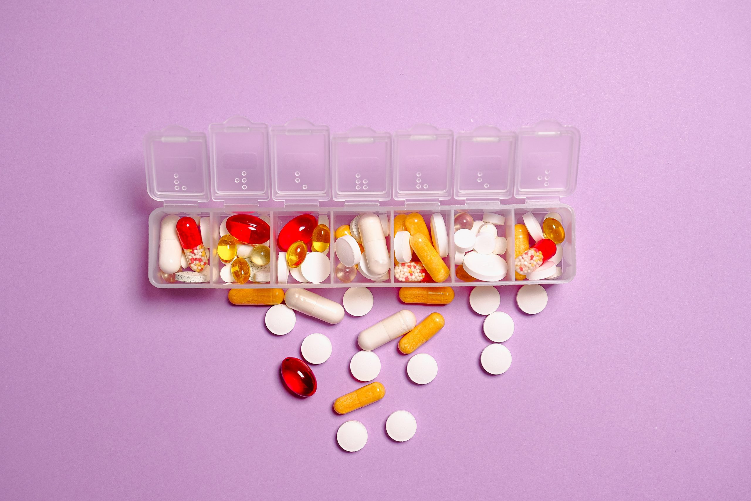 Pills on pink background; why some supplements are better than others.